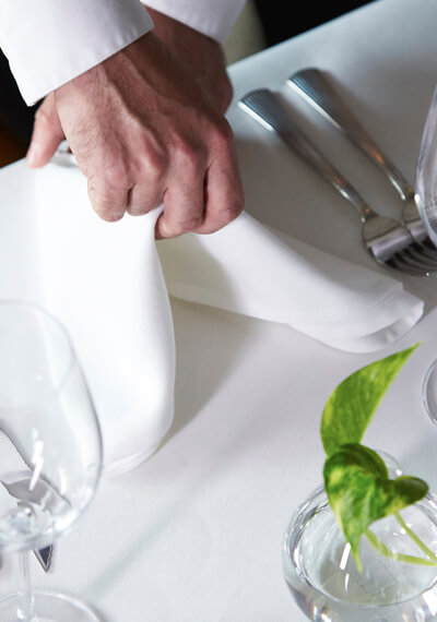 A server placing a napkin